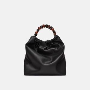 Zara black bucket bag with round handles